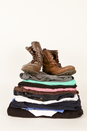 Pair of boots and old clothes for the charity shop or a jumble sale