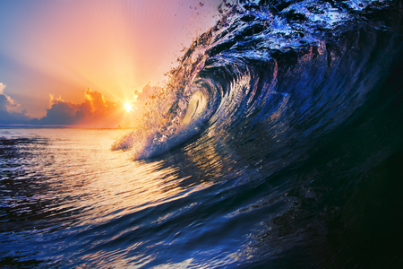 breaking down: nature marine design postcard beautiful colored breaking surfing ocean wave rolling down at sunset time