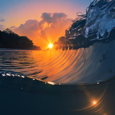 nature marine design postcard beautiful colored breaking surfing ocean wave rolling down at sunset time