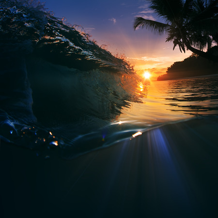 Beautiful sunset with ocean breaking wave and waterline