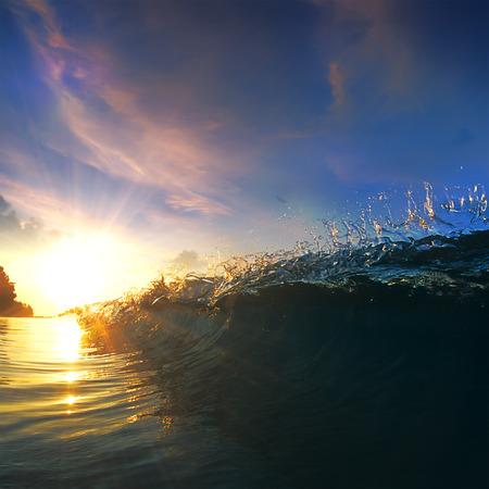 shorebreak: Beautiful blue ocean surfing wave under sunset Stock Photo