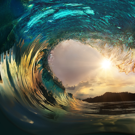Beautiful ocean surfing wave at sunset beach Banco de Imagens
