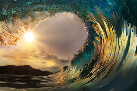 Beautiful ocean surfing wave at sunset beach Stock Photo