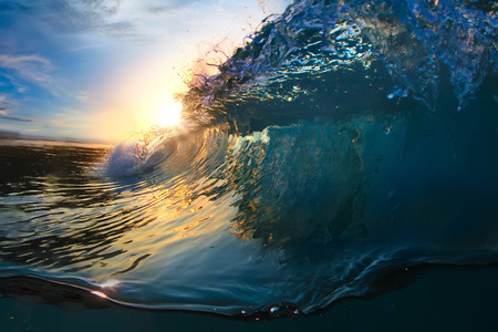 shorebreak: Beautiful ocean surfing shorebreak wave at sunset time
