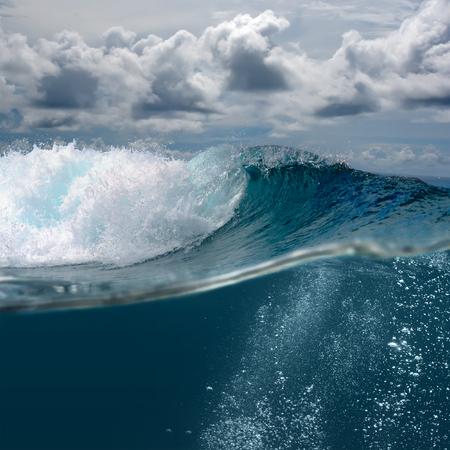 Brasking surfing ocean wave in daylight