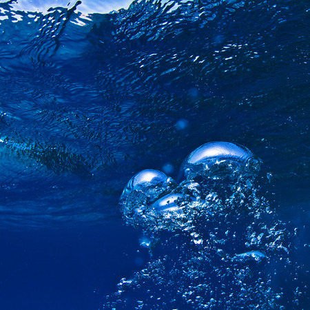 beneath the surface: abstract blue underwater surface and ripples Stock Photo