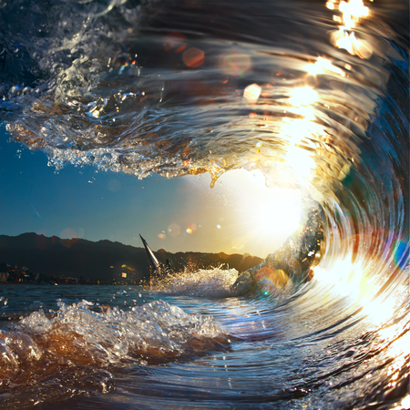 breaking wave: sunset sea curly breaking wave shining in sunlight