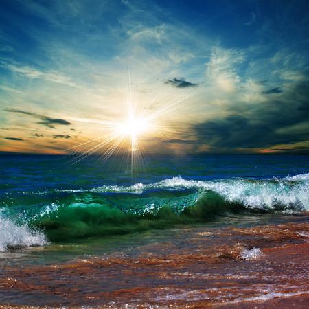 shorebreak: beautiful tropical beach with yellow sand breaking splashing curly wave under bright sunlight