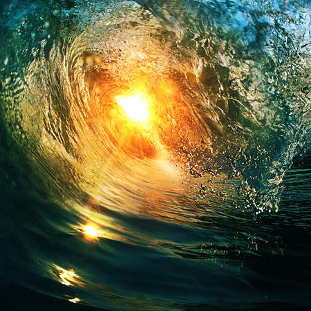 closing time: beautiful breaking surfing ocean wave closing at sunset time near tropical shore