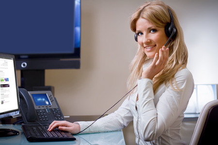 handsfree telephone: online suport call center attractive blue eyed blonde talking hands free device