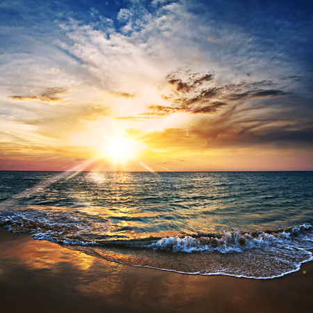 shorebreak: beautiful tropical beach with yellow sand breaking splashing shorebreak under sunset