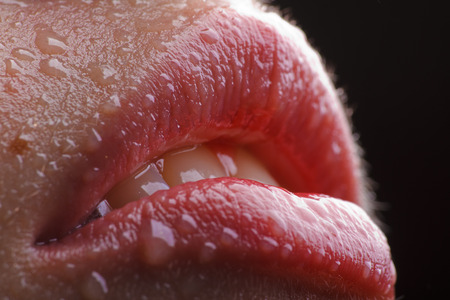 wet lips: slightly opened wet female lips with water drops on it Stock Photo