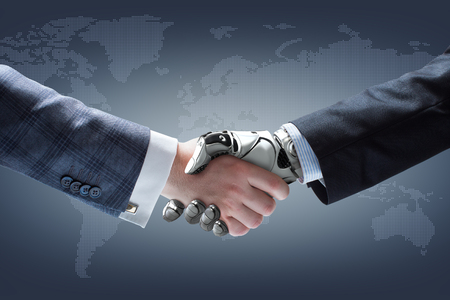 Businessman and robots handshake with holographic Earth globe on background. Artificial intelligence technology
