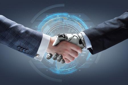 Homme d'affaires et poignée de main de robot avec holographique globe terrestre sur fond. technologie d'intelligence artificielle Banque d'images