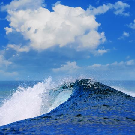 shorebreak: rough white blue ocean wave falling down