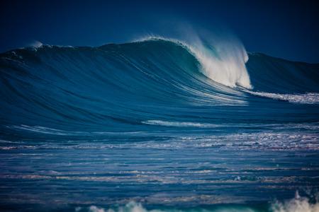 Big ocean wave on water surface of hawaiian aquatory