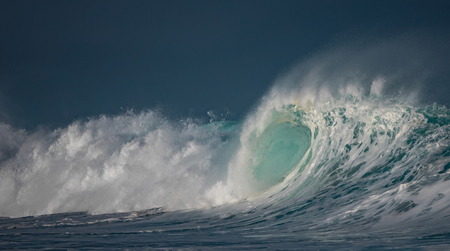 Huge waves crashing in ocean. Seascape environment background. Water texture with foam and splashes. Hawaiian surfing spots with nobody
