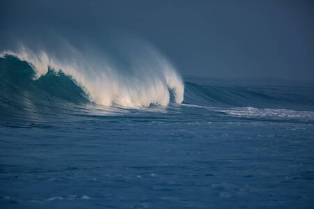 Big surfing ocean wave crashing, sunset sea background Archivio Fotografico