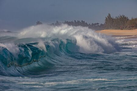 Rough Ocean Shorebreak Wave with tropical coastline