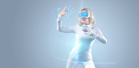 Futuristic girl working in virtual reality goggles with big data information, media technologies for business