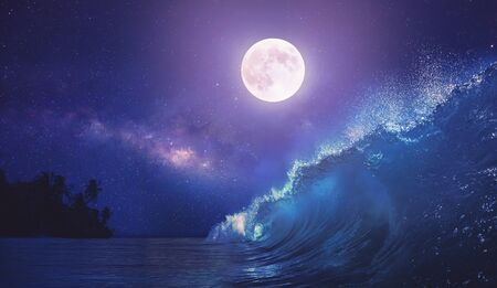 Beautiful night ocean scenery with surfing wave and full moon on tropical background
