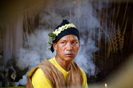 CAREY ISLAND, MALAYSIA - MARCH 17 ,2018 : A shaman of Mah Meri tribe is preparing for Hari Moyang ritual at Pulau Carey Island, Selangor, Malaysia.