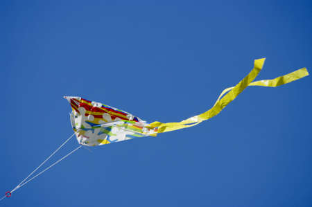 Kite in blue sky photo