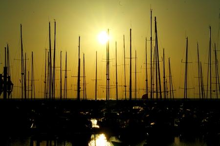 moored: sailing boats moored at sunset Stock Photo