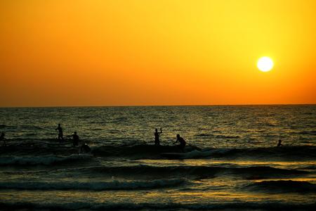 tel aviv: surfing at sunset in tel aviv