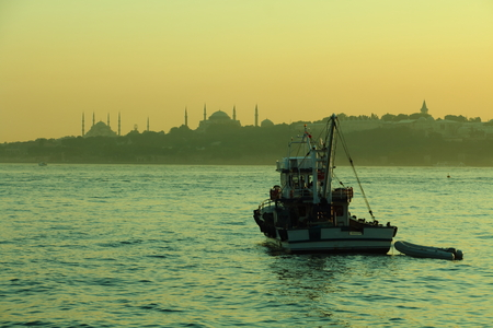 aya sofia: boat moored in bosphorus at golden hour Stock Photo