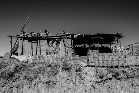 clay abandoned house Standard-Bild