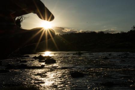 grabbing: grabbing sun at sunset