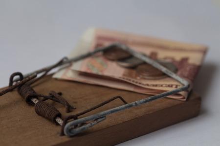debt trap: trapper with money
