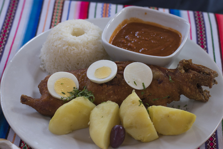 guinea pig meat with potatoes and rice