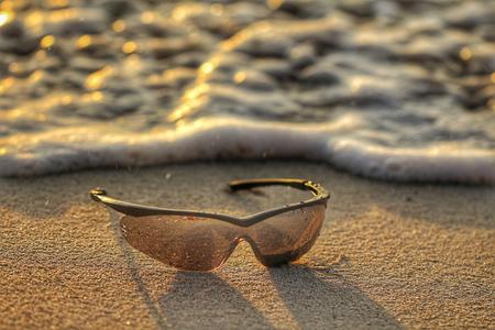 Sunglasses on the beach Stockfoto