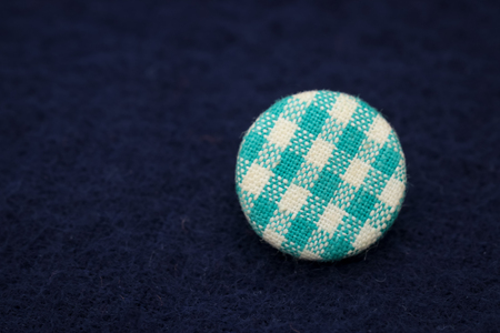 button, white and light blue grid