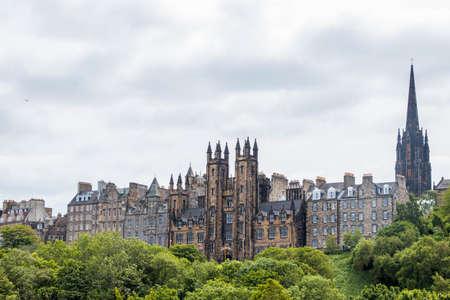 cityscape of Edinburgh behind trees
