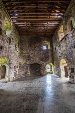 stone walls and broken walls in an old abandoned castle Standard-Bild