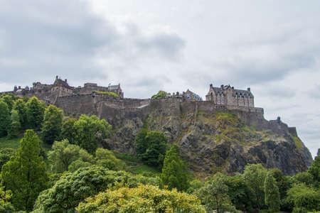 Edinburgh castle on top mountain from far Editorial