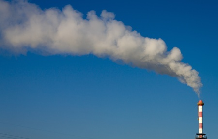 smoke chimney of incinerator in the blue sky