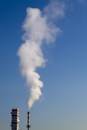 incinerator: smoke chimney of incinerator in the blue sky