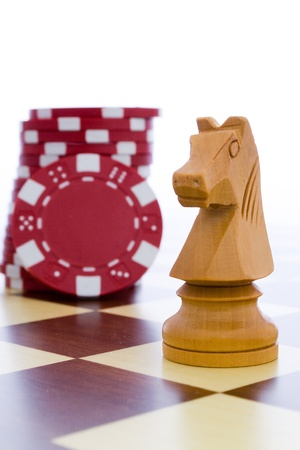 white horse and red chips in the chessboard Stock Photo - 8548124