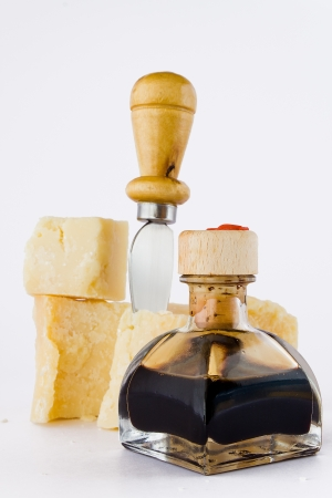 balsamic vinegar: balsamic vinegar and parmesan with knife isolated white background Stock Photo