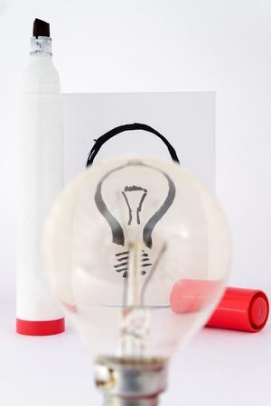 real lightbulb and illustration lightbulb focus with drawing pen Stock Illustration - 8577560