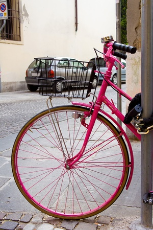 front wheel of all pink bicycle photo