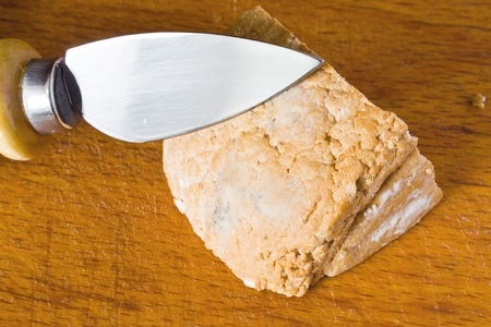 closeup of smoked ricotta with cheese knife on the table photo