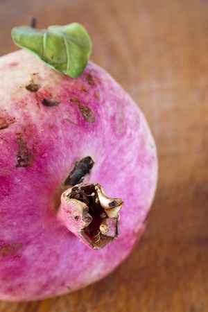 ripe pomegranate on the table photo