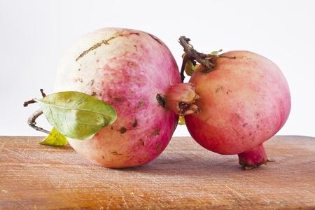 ripe pomegranate on the table photo