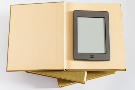 photography of ereader above the books photo