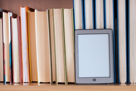 ereader placed on the books of a library Stock Photo - 17405734